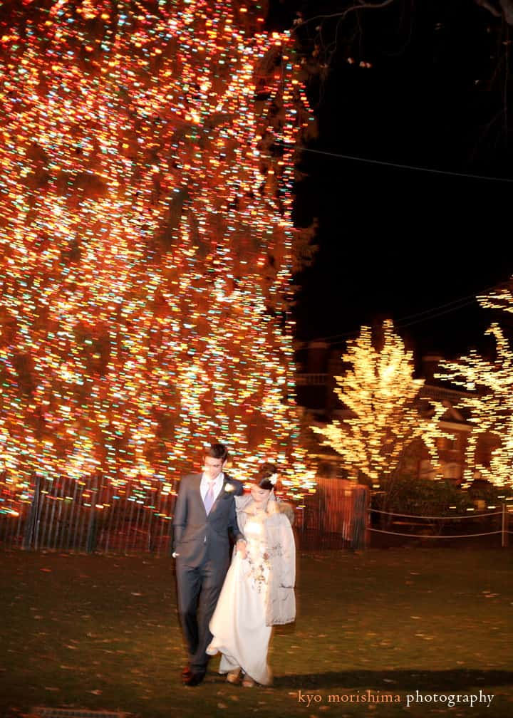 Portrait of the bride and groom near Palmer Square's Christmas lights in Princeton, photographed by Kyo Morishima.