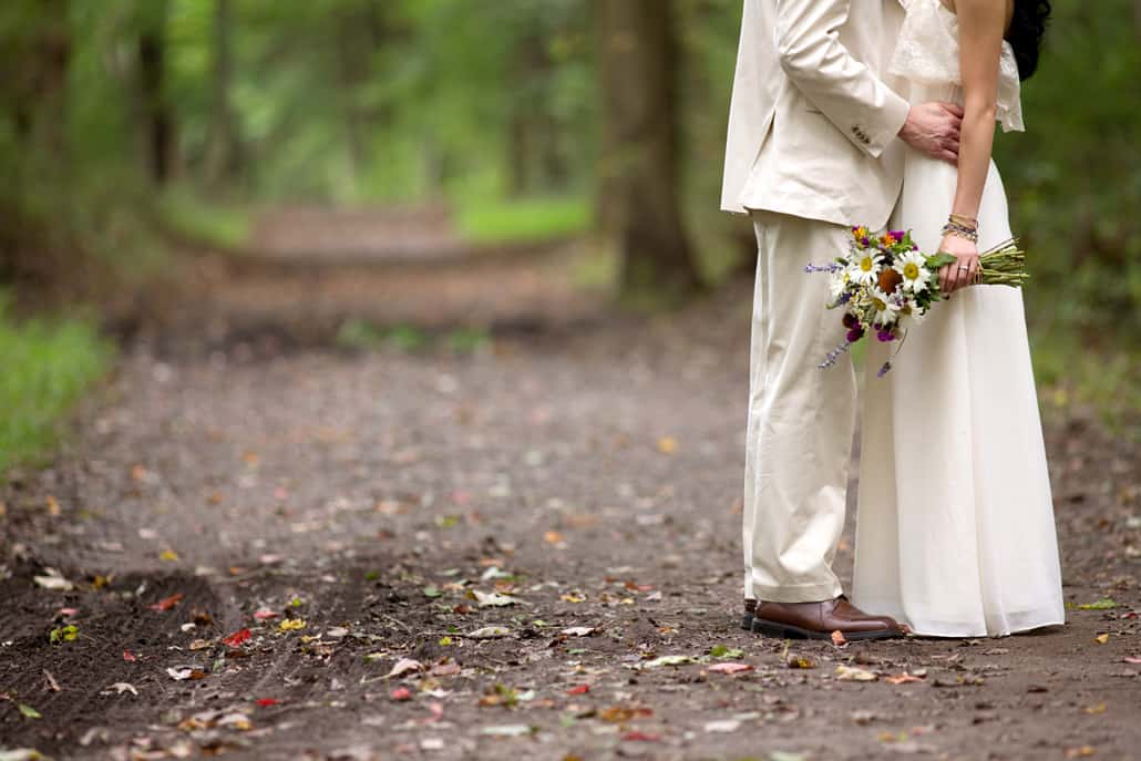 bride groom on a trail bouquet