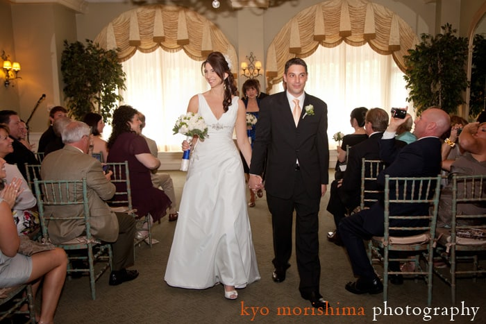 The bride and groom recess at the Bernards Inn, photographed by NJ wedding photographer Kyo Morishima.