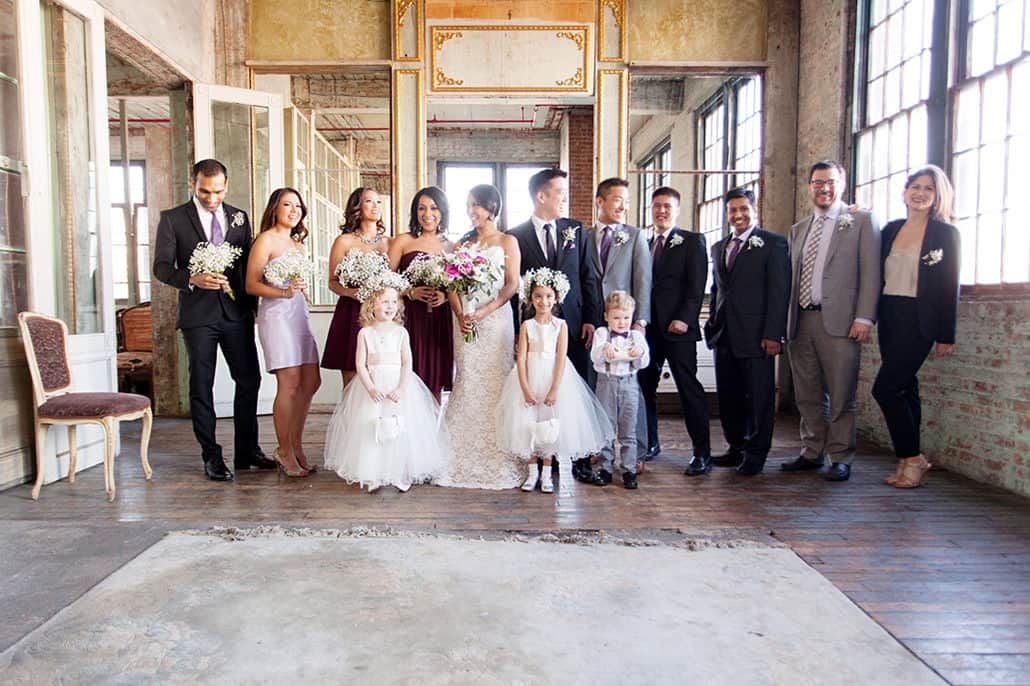 Wedding party group portrait on 3rd floor at Metropolitan Building in Long Island City, NY
