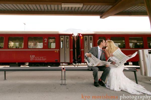 Bride and groom read newspaper in Switzerland, by destination wedding photographer Kyo Morishima