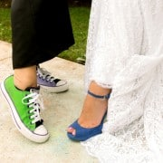 Bride wearing L.K. Bennett blue heels with Inbal Dror wedding dresses poses with guest wearing mismatched color sneakers, photographed by Kyo Morishima