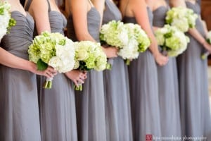 Bridesmaids in grey dresses with hydrangea bouquets at Kimisis Southampton Greek Orthodox Church, photographed by Hamptons wedding photographer Kyo Morishima