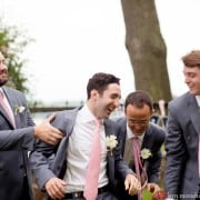 Groomsmen wearing pink ties tackle the groom, photographed by Kyo Morishima