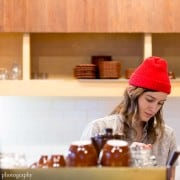 Barista with red hat at Blue Bottle Coffee in Williamsburg, photographed by Kyo Morishima