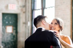 Bride and groom kiss during portrait session at Metropolitan Building wedding, photographed by NYC wedding photographer Kyo Morishima