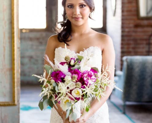 Bride with bouquet of fuschia peonies and white astilbe from Flower Muse, designed by Krystle DeSantos, photographed by Kyo Morishima