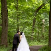 Wedding kiss under the trees, photographed by Tarrytown wedding photographer Kyo Morishima