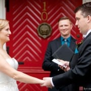Bride and groom in front of Nassau Inn red door, photographed by Princeton wedding photographer Kyo Morishima