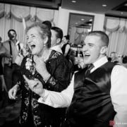 Grandmother and grandson dance together during Nassau Inn wedding, photographed by Kyo Morishima