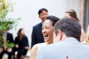 Bride laughs during Invisible Dog wedding ceremony, photographed by Boerum HIll wedding photographer Kyo Morishima