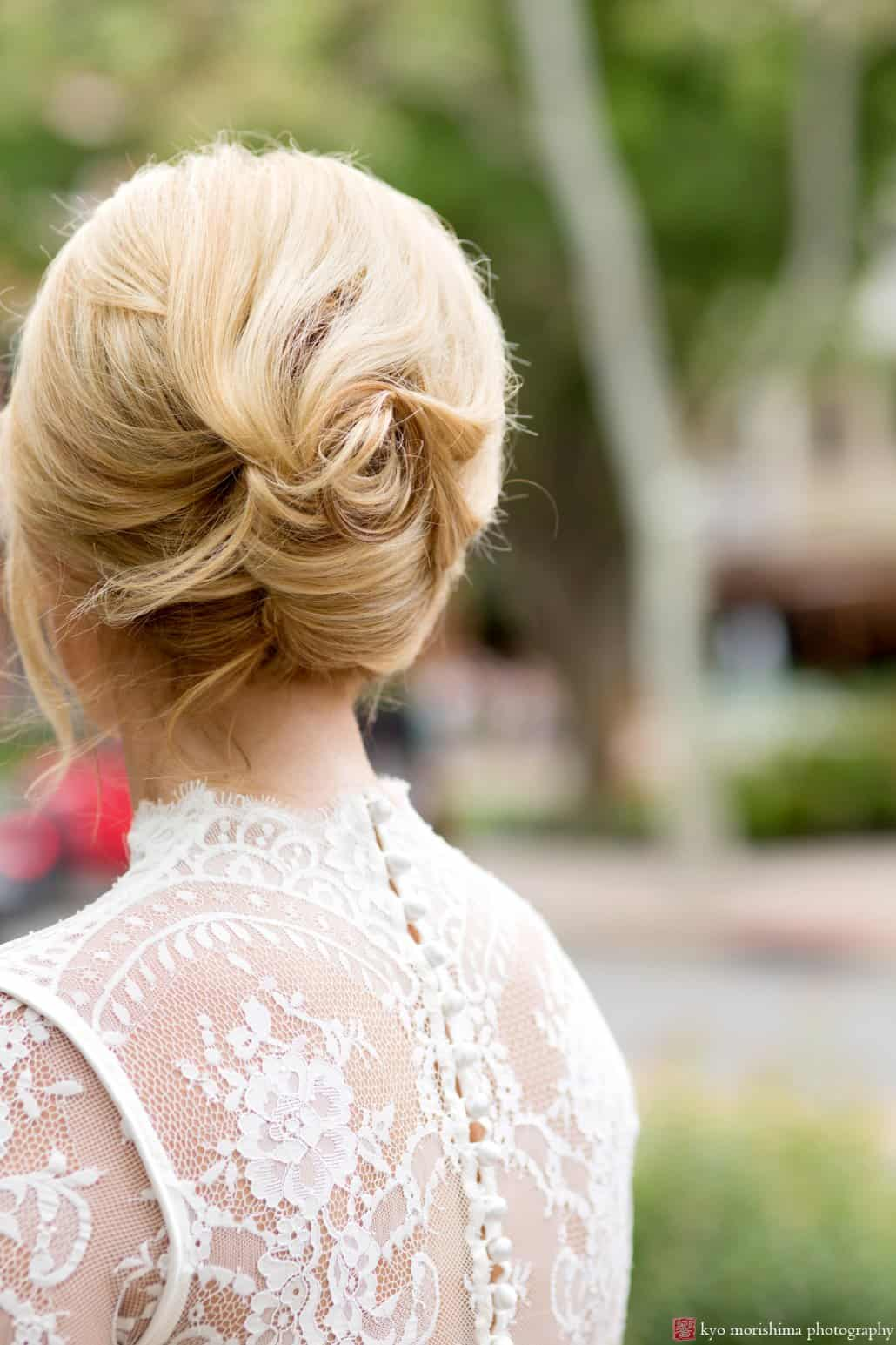 Bride with 1960s style updo by Letitia Kakas, detail of back of BHLDN Bridgette wedding dress, photographed by Kyo Morishima