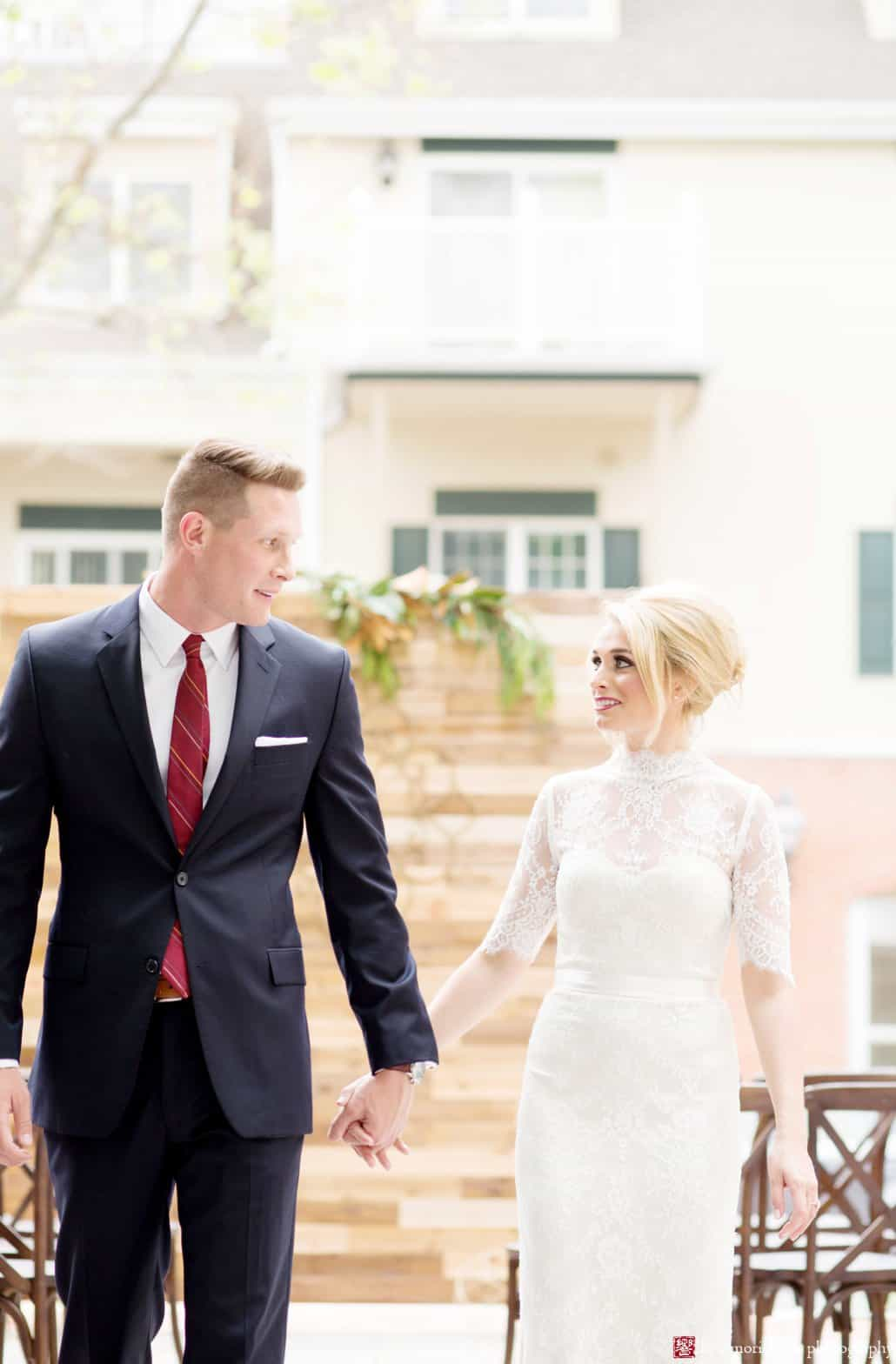 "Bride and groom on the patio at Nassau Inn ""Madmen"" wedding shoot styled by Kristin Rockhill of Details of I Do; bride wears BHLDN Bridgette dress with hair by Letitia Kakas and makeup by Gina Verde Longo, photographed by Kyo Morishima"
