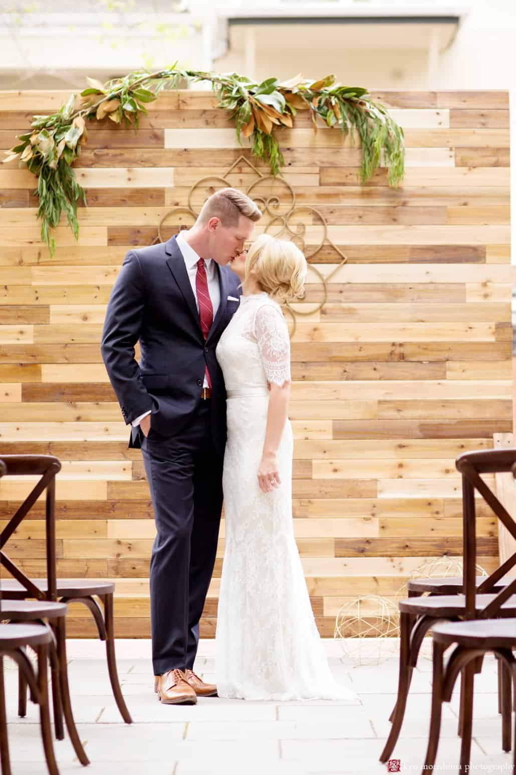 """Bride and groom on the patio at Nassau Inn """"Madmen"""" wedding shoot styled by Kristin Rockhill of Details of I Do; bride wears BHLDN Bridgette dress with hair by Letitia Kakas and makeup by Gina Verde Longo, photographed by Kyo Morishima"""
