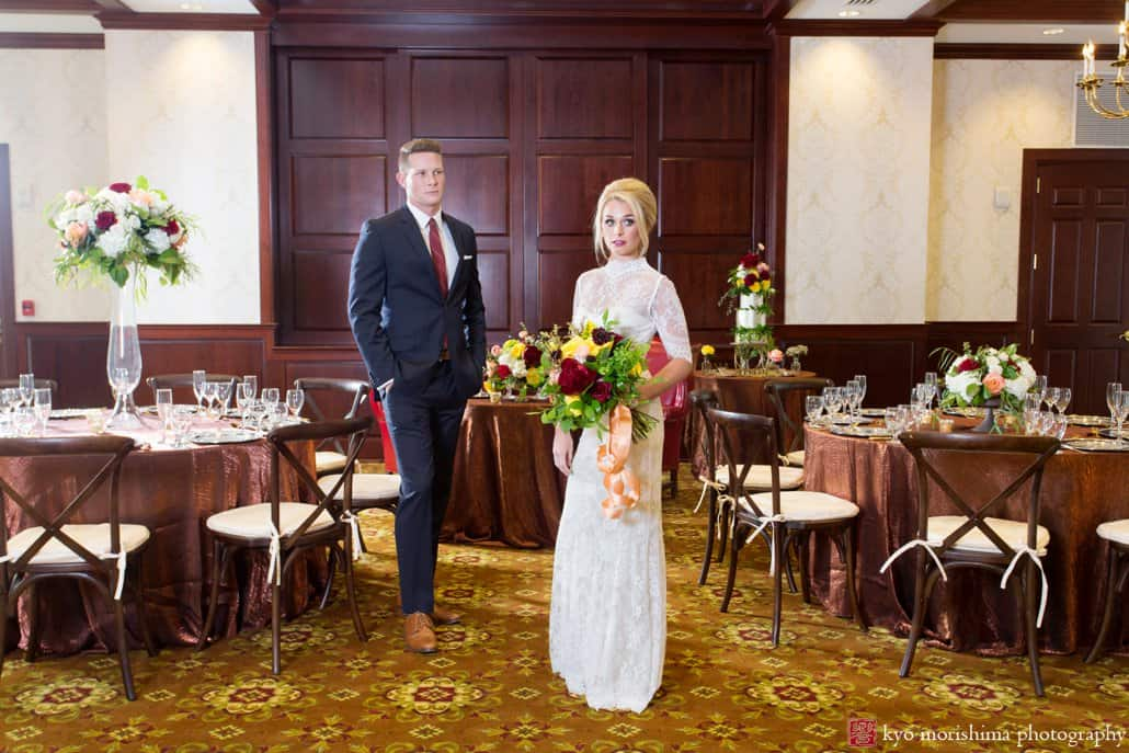 "Bride and groom stand in the ballroom at Nassau Inn ""Madmen"" wedding photo shoot styled by Kristin Rockhill of Details of I Do, photographed by Kyo Morishima"