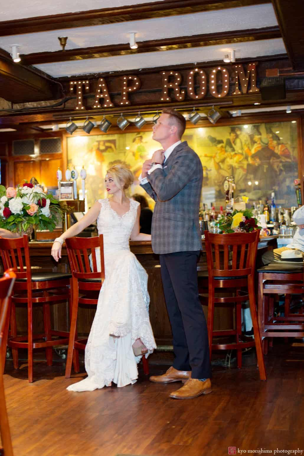 "Bride and groom in Nassau Inn's Yankee Doodle Tap Room during ""Madmen wedding"" 1960-s style photo shoot designed by Kristin Rockhill of Details of I do, photographed by Kyo Morishima"