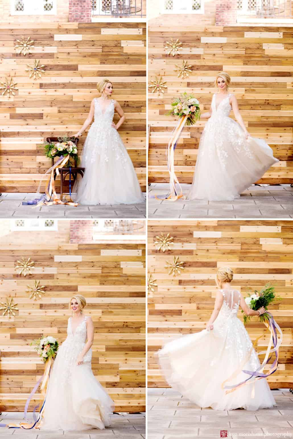 "Bride wearing Ariane wedding gown from BHLDN twirls in front of wood backdrop at Nassau Inn ""Madmen"" photo shoot styled by Kristin Rockhill of Details of I Do, photographed by Kyo Morishima"