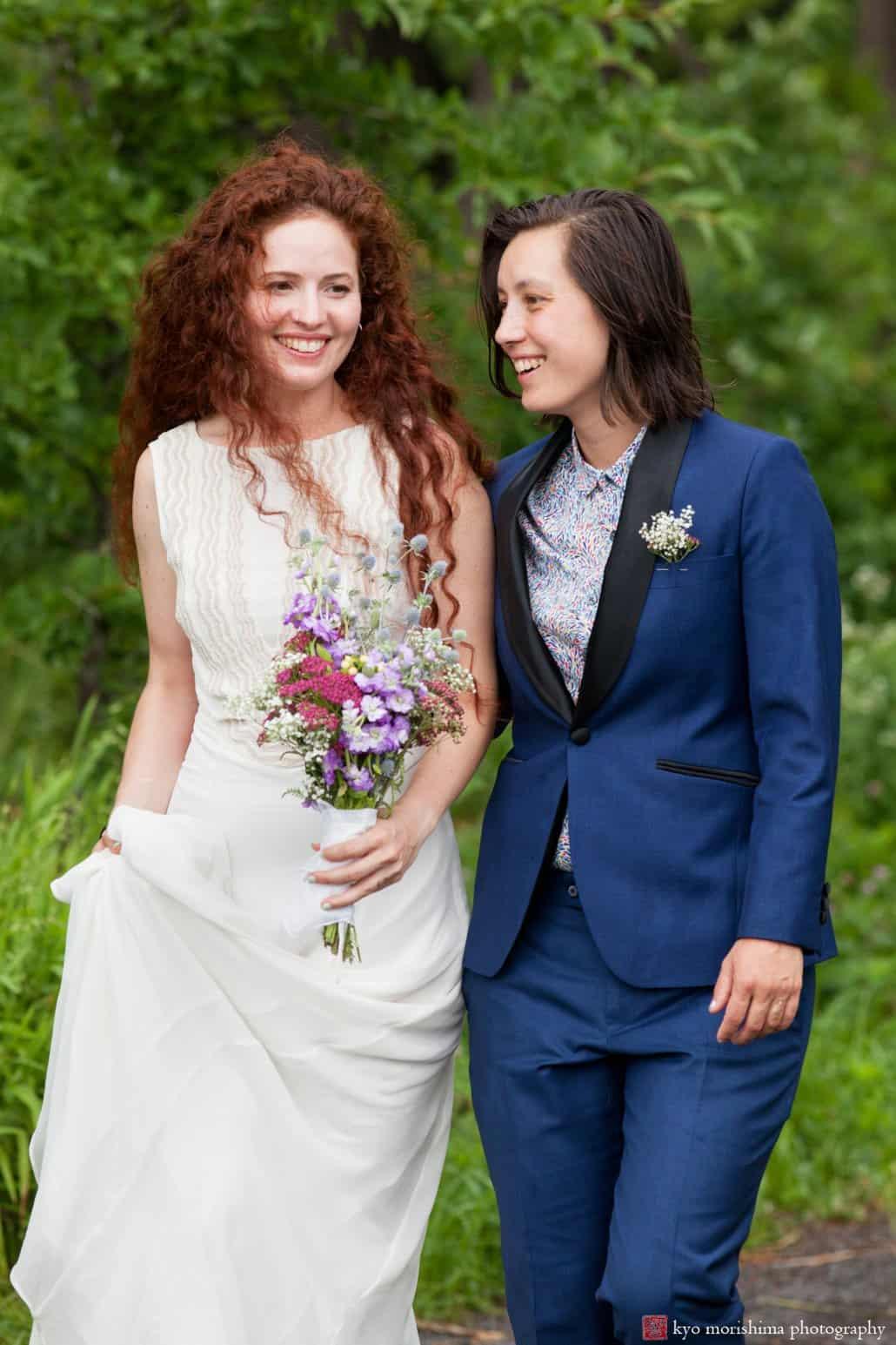 LGBT wedding portrait at Washington Avenue Pier in Philadelphia; bride wears Mara Hoffman wedding dresss and her partner wears Bindle and Keep custom suit; photographed by Kyo Morishima
