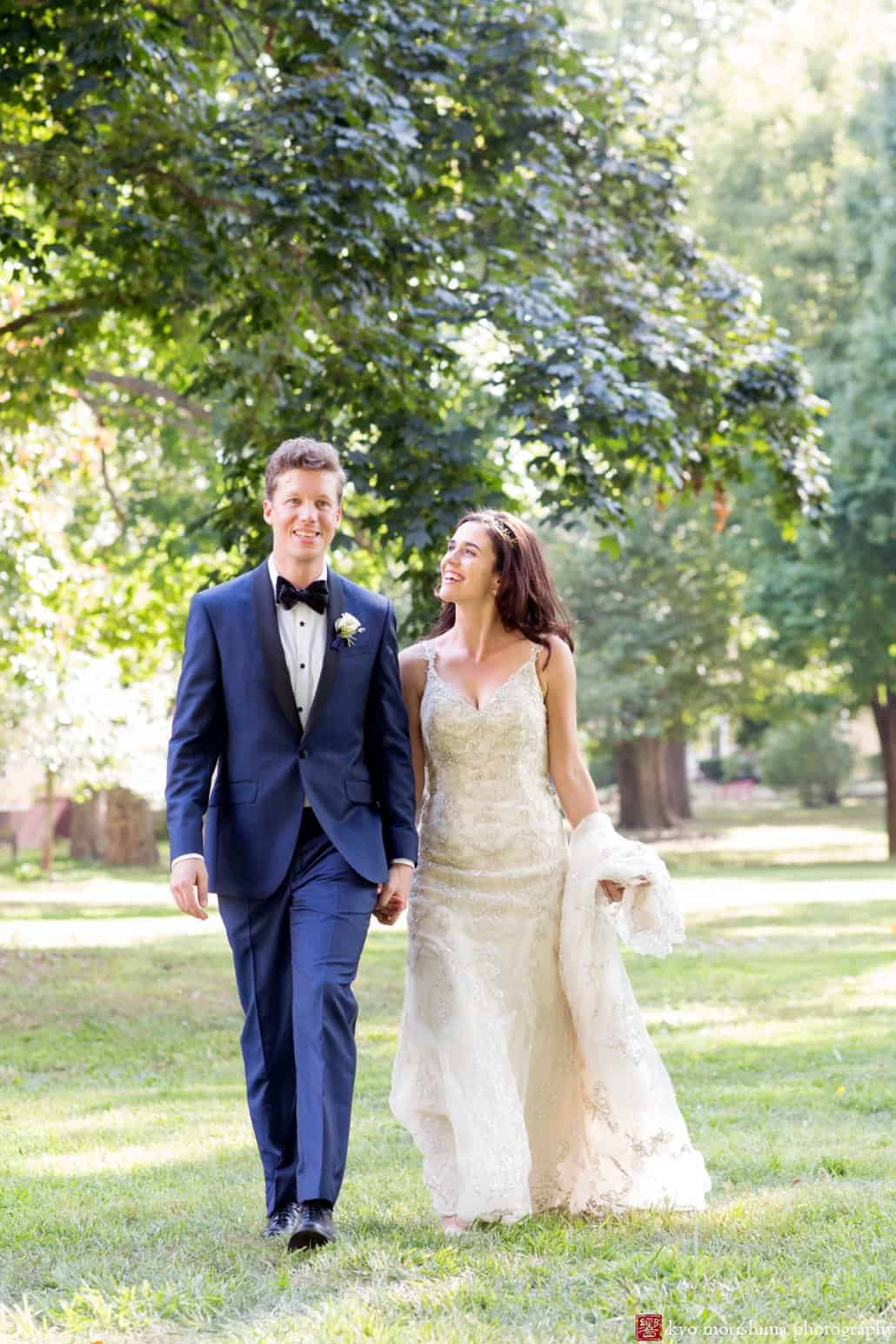 Bride And Groom Walk Across The Lawn Before Governors Island Wedding Ceremony Wears Maggie
