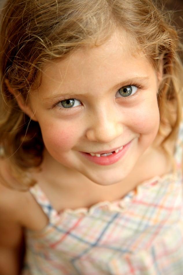 Outdoor, candid child portrait photographed by NJ portrait photographer Kyo Morishima