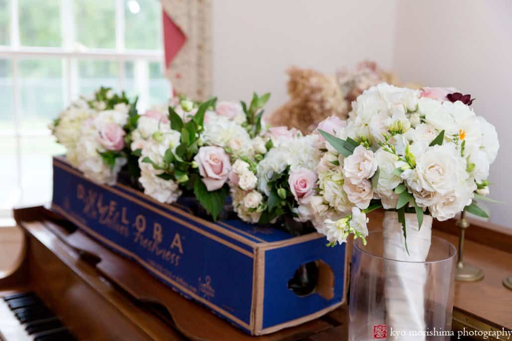 Wedding flowers from Viburnum on the dining room table at bride's grandparents' house, photographed by Kyo Morishima