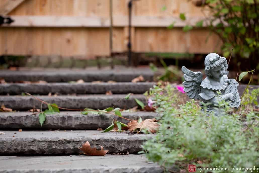 Princeton garden vignette with stone angel statue photographed by Kyo Morishima