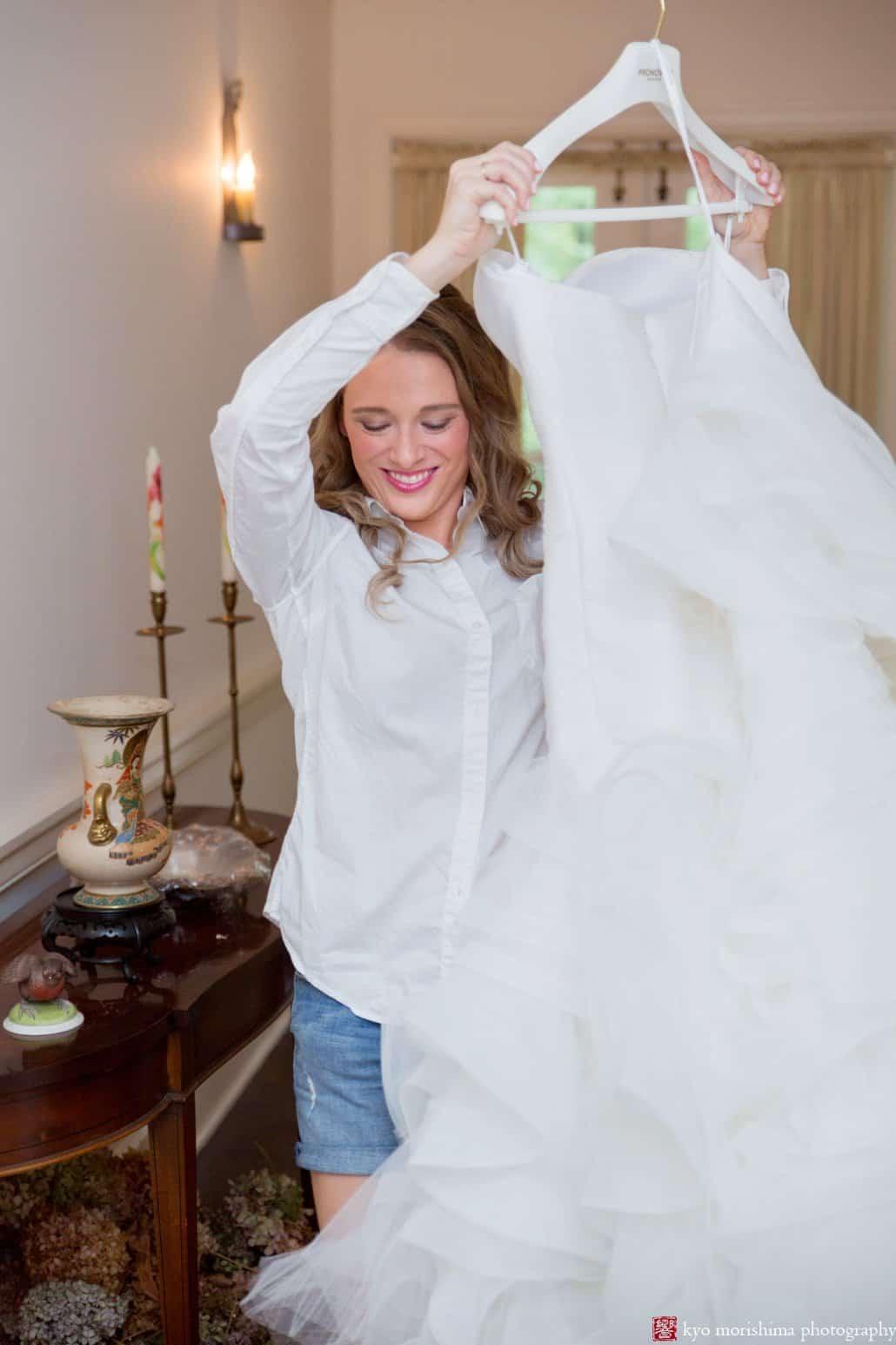 Bride carrying Pronovias wedding dress