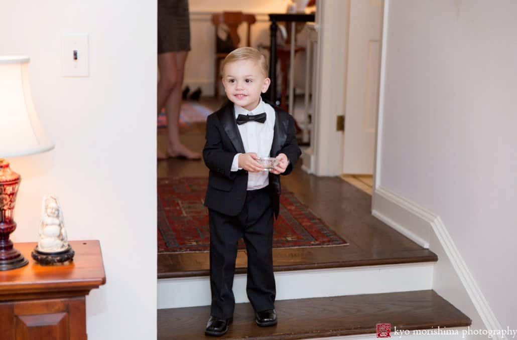 Ringbearer sees bride for the first time as he enters living room in Princeton home