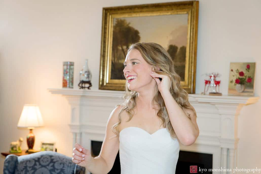 Bride smiles as she glances back at friends after getting ready in her grandparents' home in Princeton