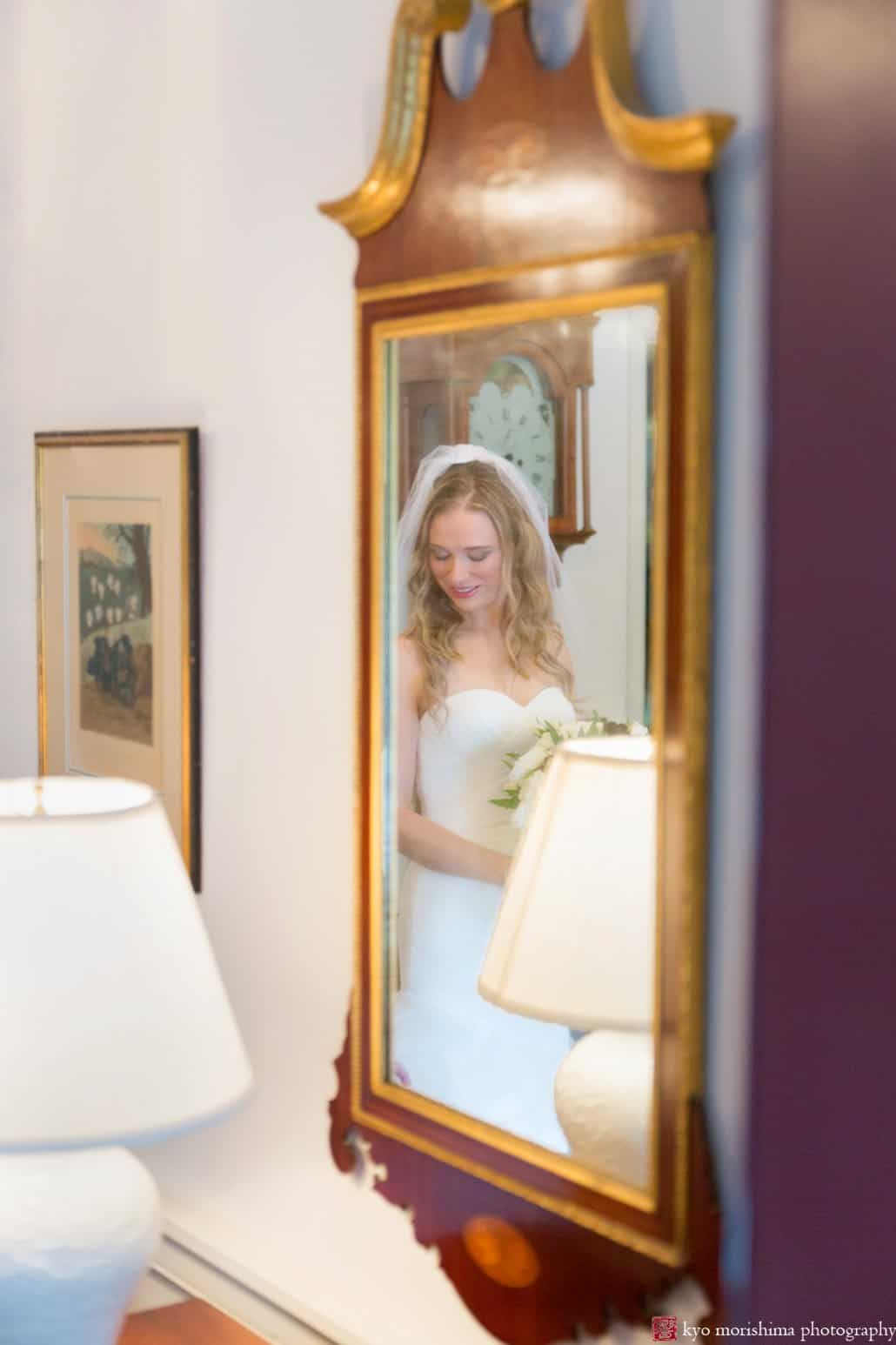 Bride reflected in a Colonial mirror in her grandparents' home in Princeton