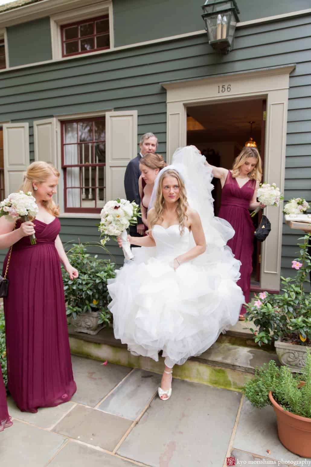 Bride emerges from grandparents' house wearing filmy ruffled Pronovias wedding gown