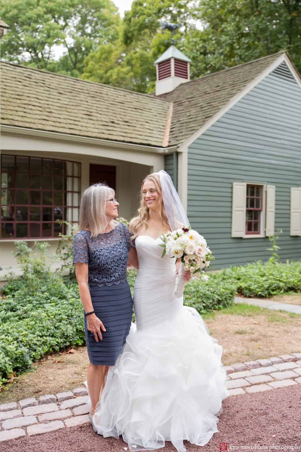Bride and mother pose for a picture outside grandparents' home before Princeton wedding begins
