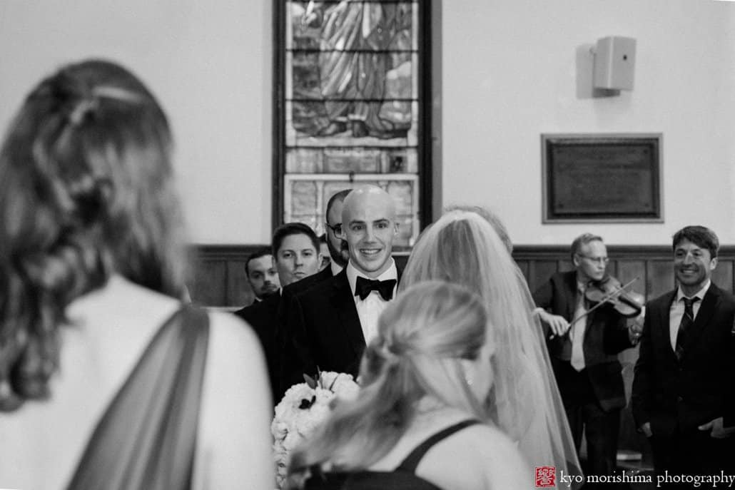 Groom looks at bride as she arrives at alter for Princeton United Methodist Church wedding