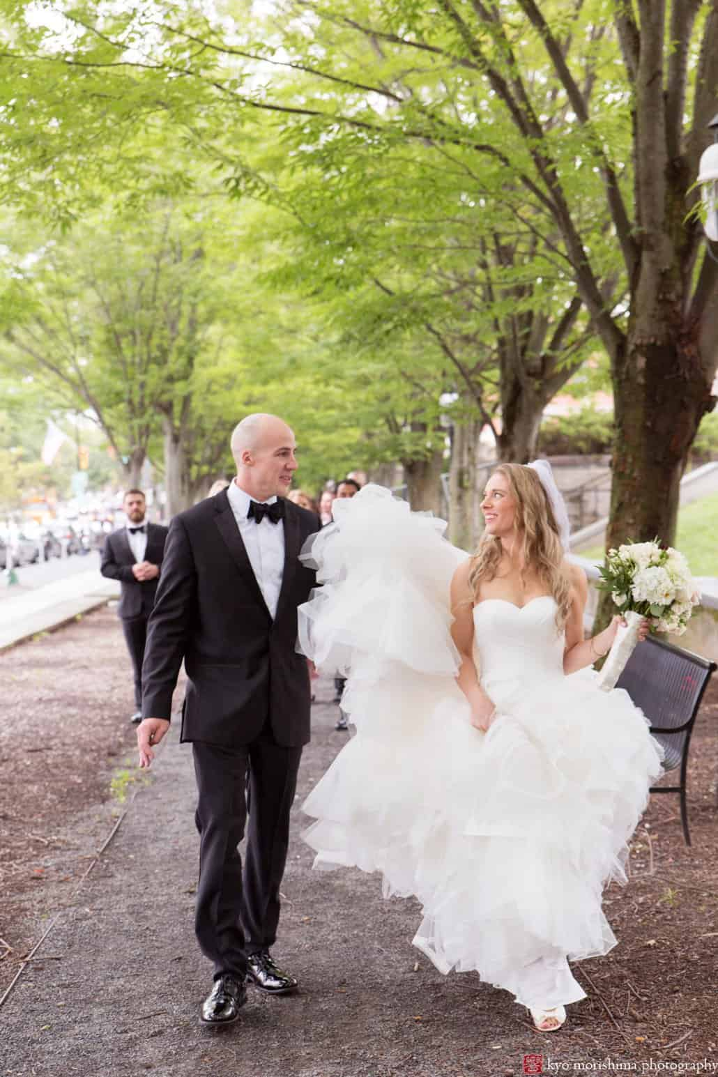 Bride and groom walk down the street for Princeton portrait session