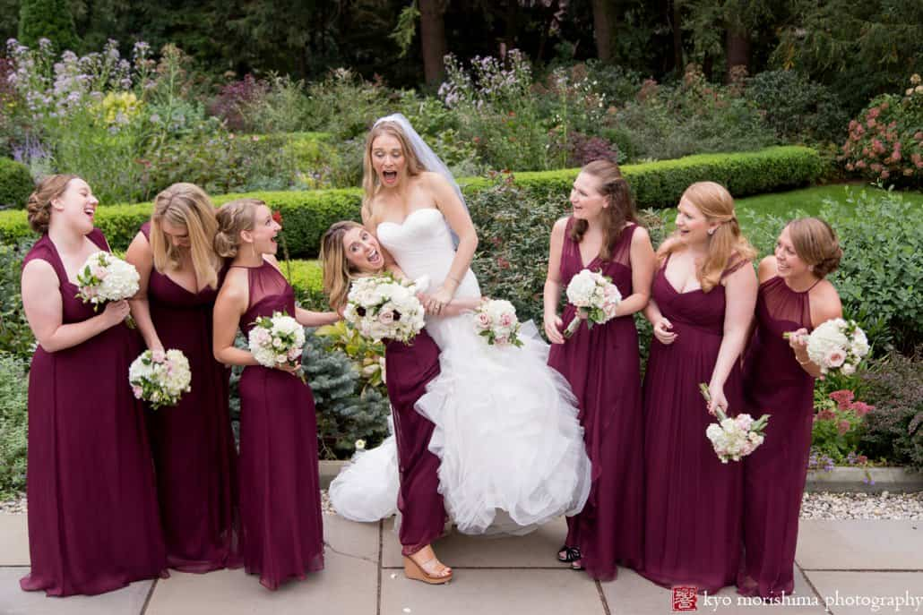 Maid of honor lifts bride for a goofy moment during Prospect Gardens wedding portrait session