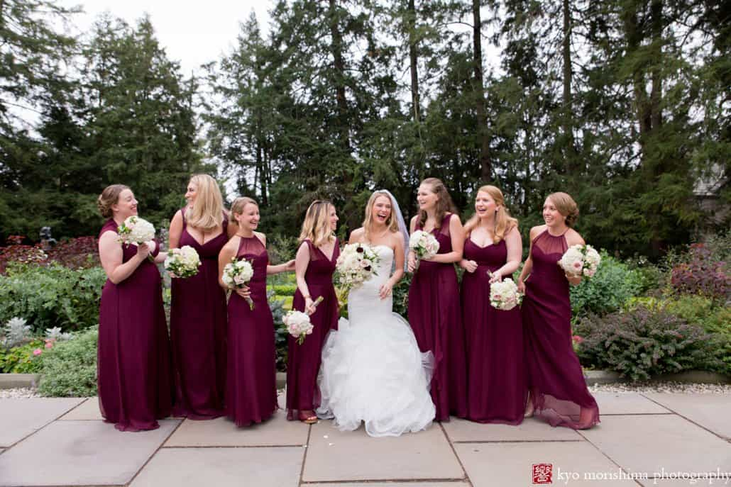 Bride and bridesmaids have fun during Prospect Gardens wedding portrait session in Princeton