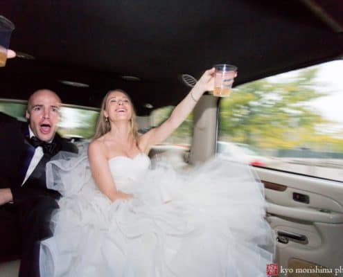 Bride and groom toast during A-1 Limo ride to Princeton wedding reception