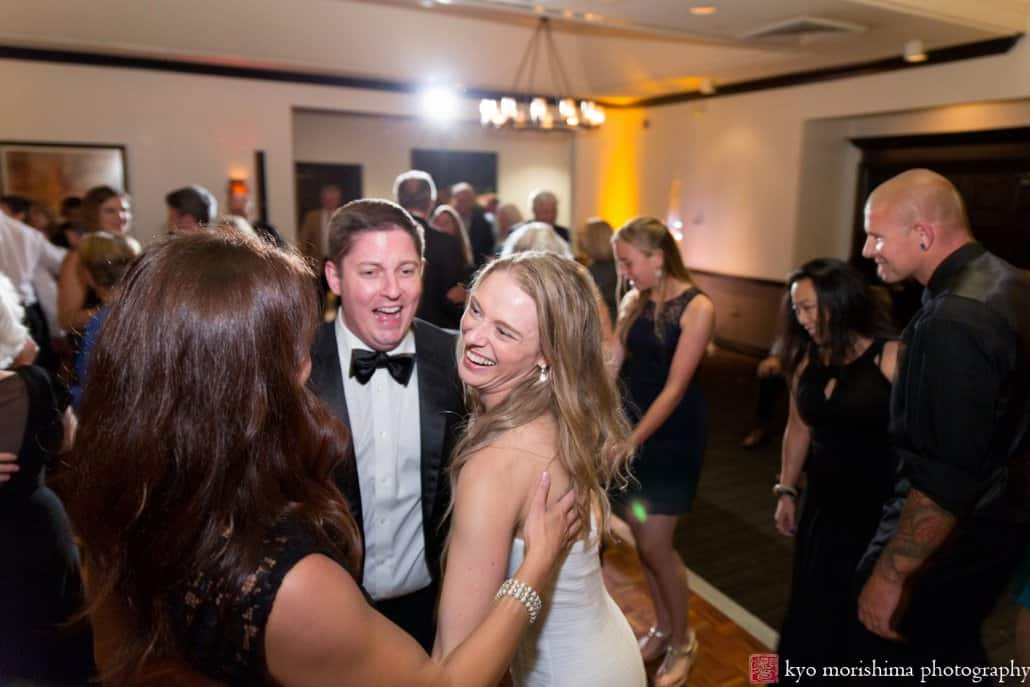 Bride smiles at friends during Cherry Valley Country Club wedding reception
