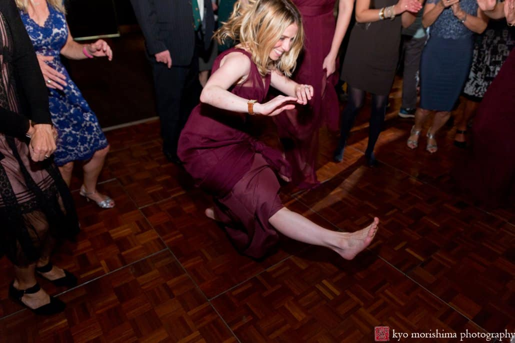 Maid of honor shows off her dance moves during Cherry Valley Country Club wedding reception with music by 74 Events