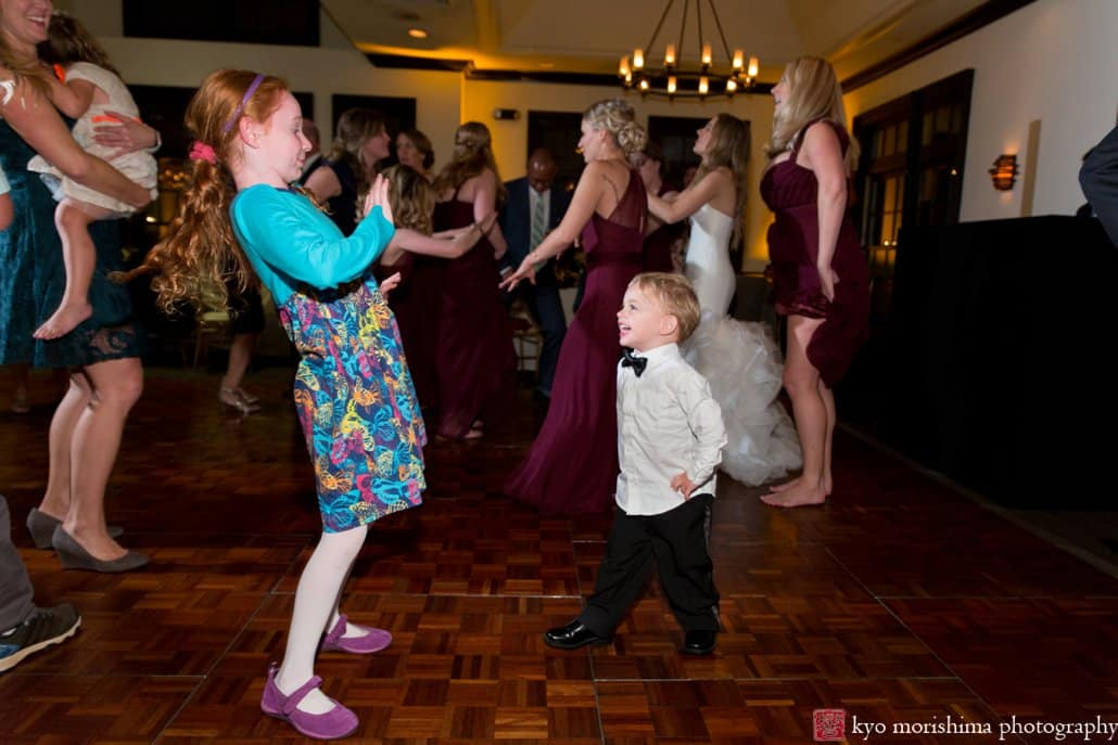 Girl and little boy laugh with each other during Cherry Valley Country Club wedding dance