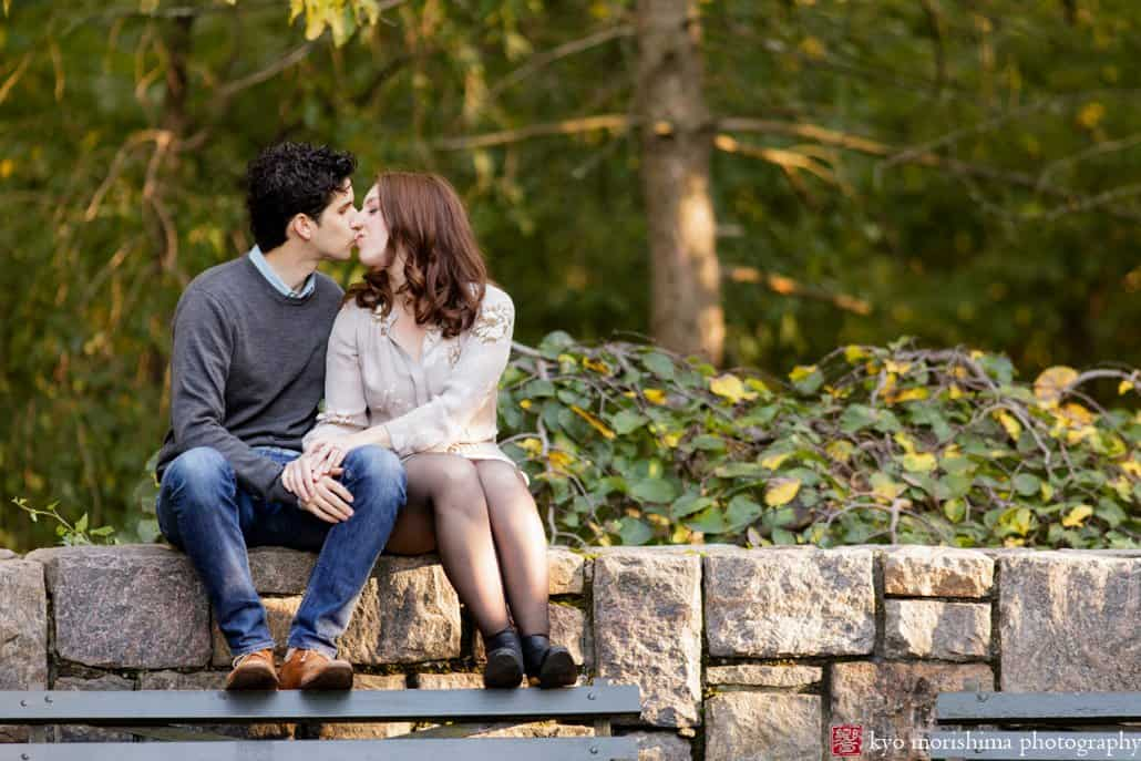 Prospect Park engagement photo on a stone wall photographed by Kyo Morishima