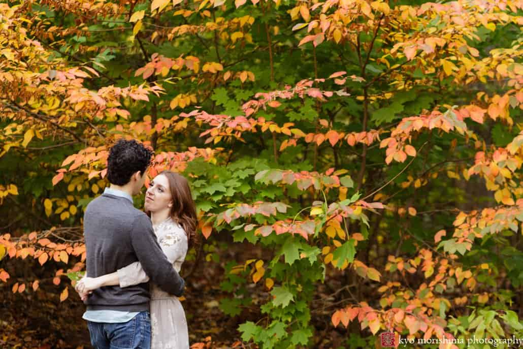 Engagement photo with fall leaves in the background at Prospect Park in Brooklyn, photographed by Kyo Morishima