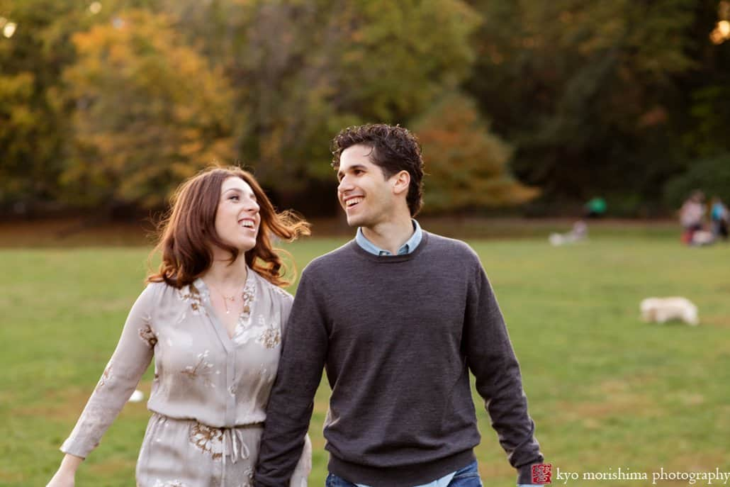 Couple enjoying a walk on the lawn at Prospect Park; engagement picture photographed by Kyo Morishima
