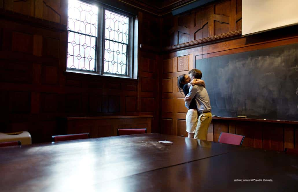 A couple kiss passionately inside a Princeton University classroom during engagement session photographed by Kyo Morishima