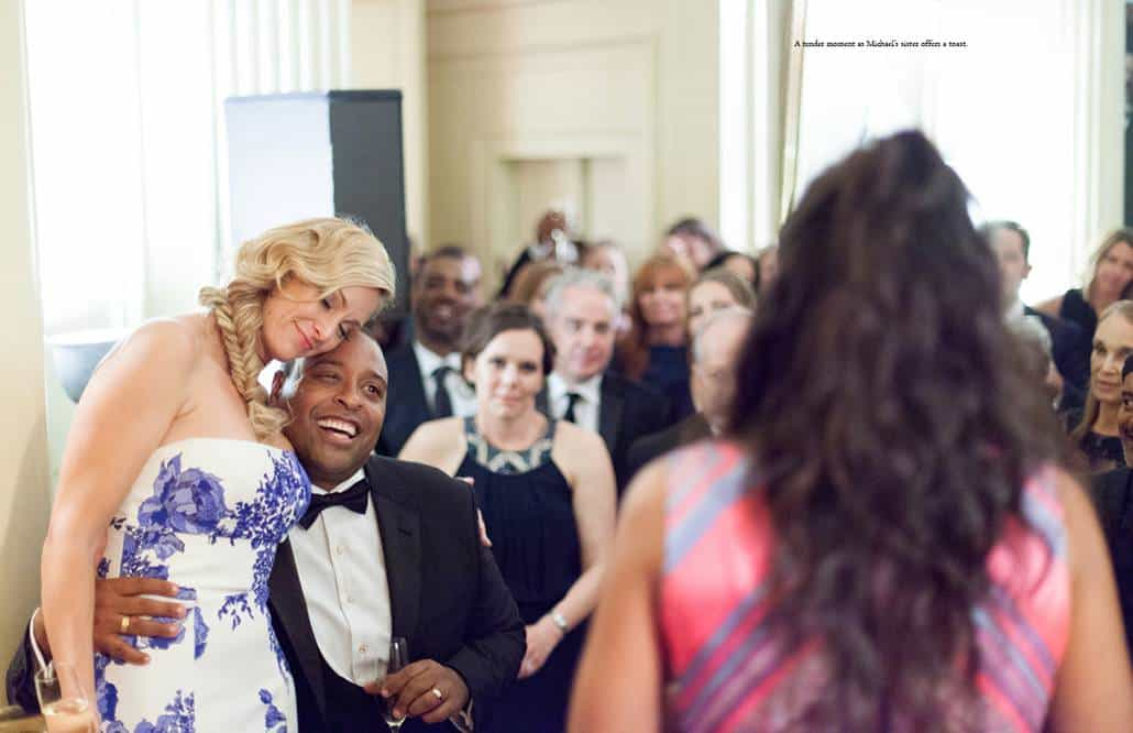 Bride wearing Monique Lhuillier and groom listen to toast by groom's sister during Lotos Club wedding reception