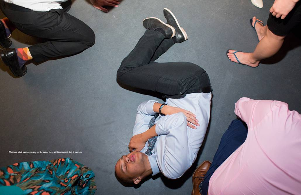 A wedding guest in the fetal position during raucous dancing at Green Building wedding with DJ OP!