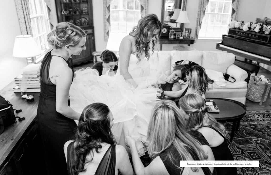 Bride gets ready in the living room, surrounded by a posse of bridesmaids helping with her Pronovias wedding dress