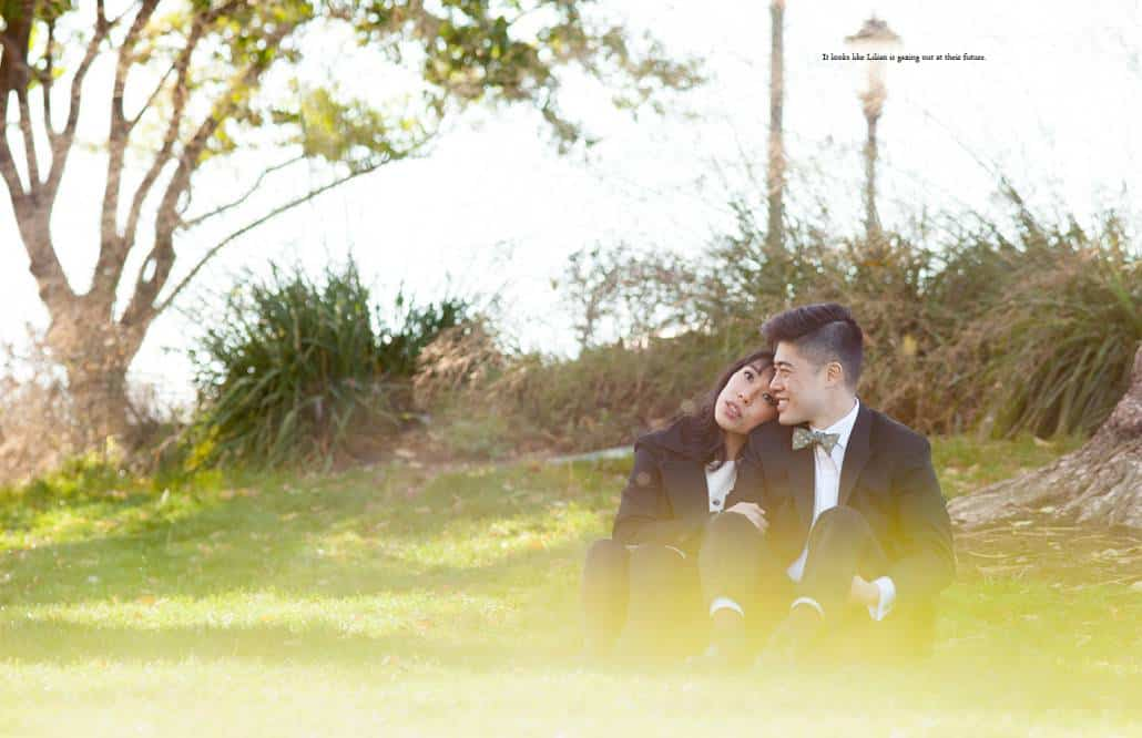 Couple sits on the grass in a lower Manhattan park, photographed by NYC documentary wedding photographer Kyo Morishima