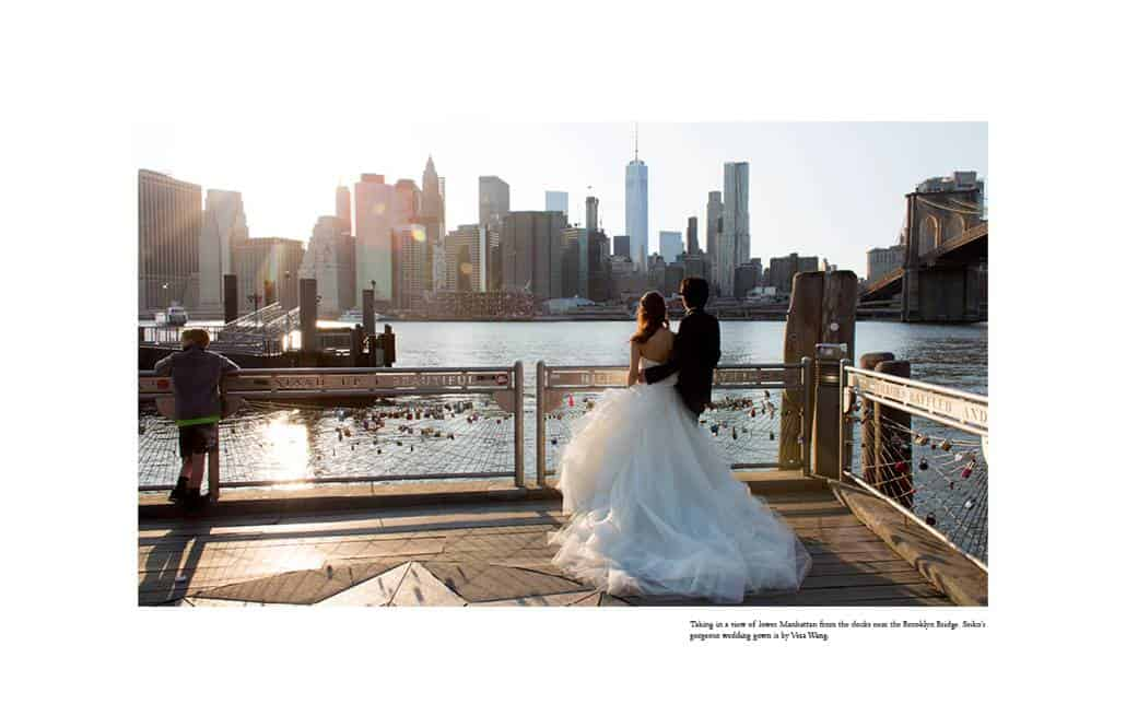Japanese bride and groom gaze out at Manhattan from next to the Brooklyn Bridge; iconic Brooklyn wedding photo by Kyo Morishima