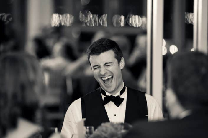 Groom laughing at Battery Garden Wedding Reception, NYC